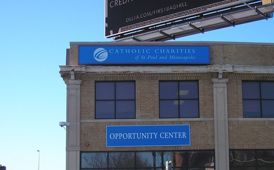 Catholic Charities building cabinet sign